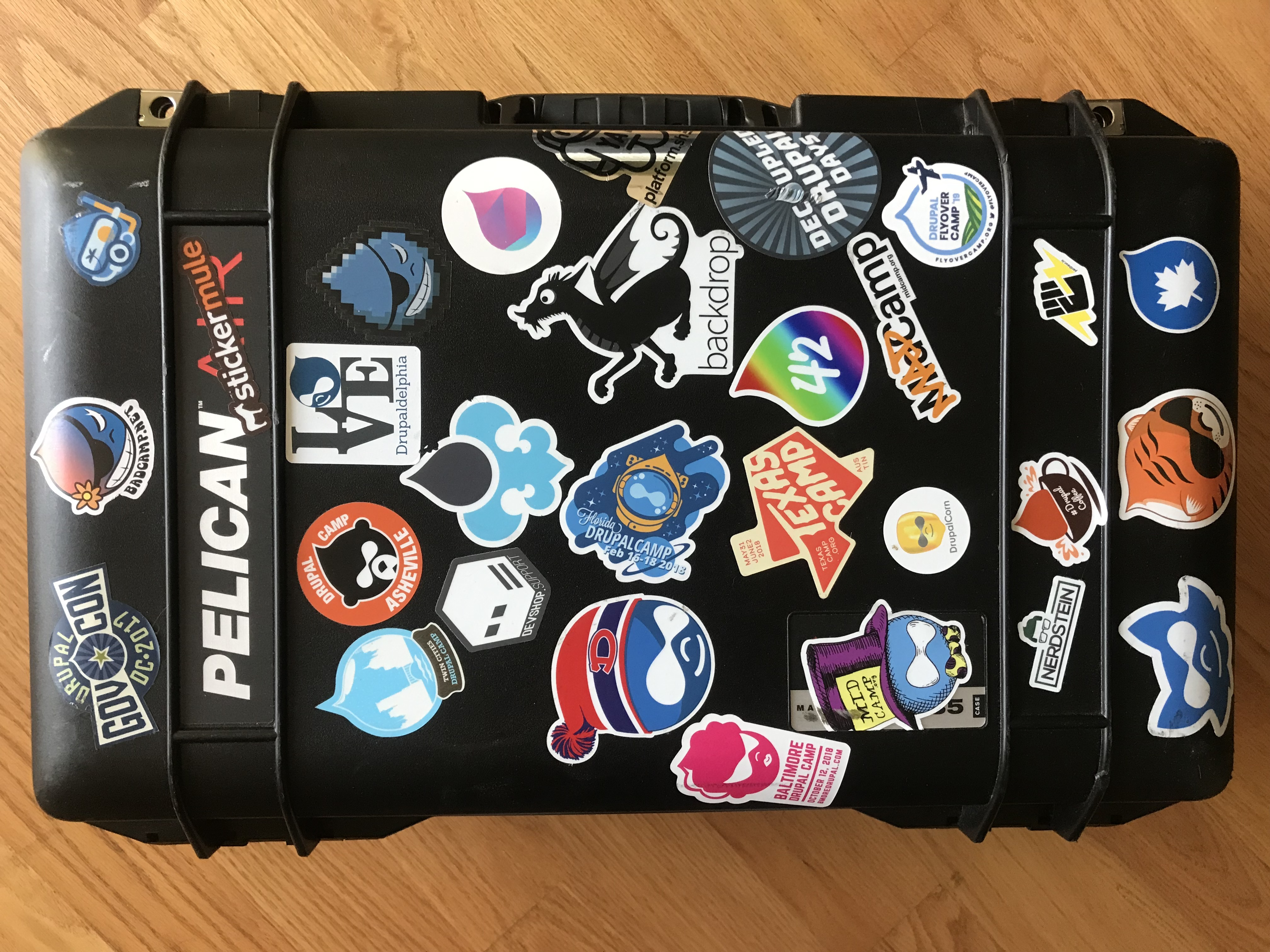 Pelican case covered in Drupal camp stickers